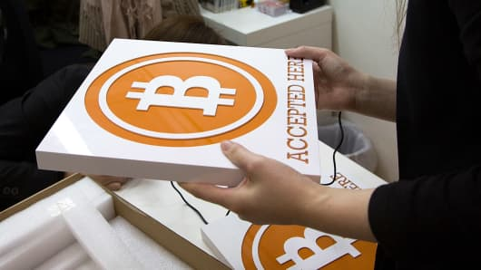 People attend a bitcoin retail store opening in Hong Kong.