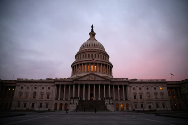 The American flag flies over the Senate side of the U.S. Capitol.