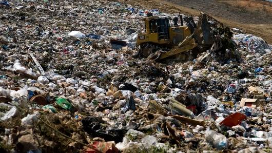A bulldozer pushes trash into piles at the Miramar Landfill in San Diego, California.