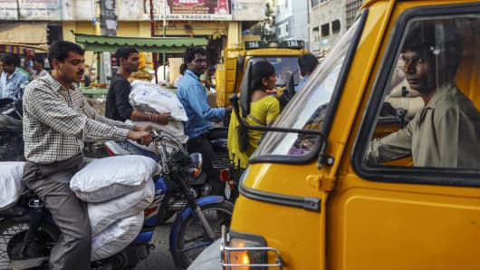 Vehicles sit in traffic at the Begum Bazaar in Hyderabad, India