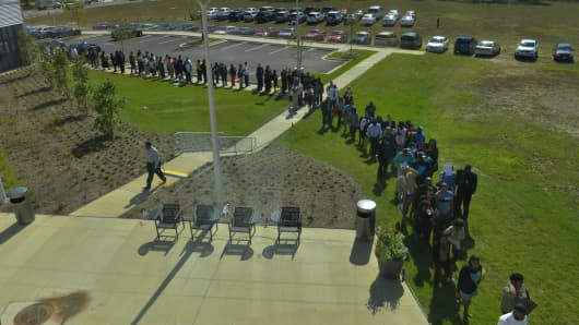 Applicants line up for a job fair in Fort Washington, Md., on Sept. 17, 2013.