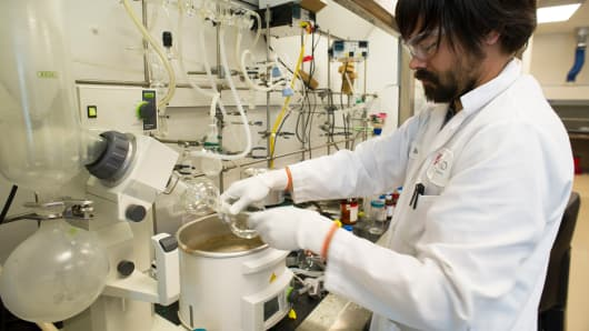 A researcher works on a hepatitis C virus drug at Gilead Sciences lab in Foster City, Calif.