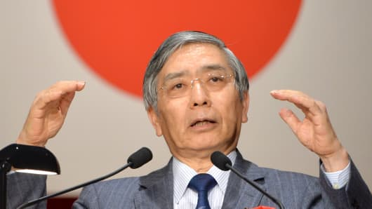 Bank of Japan Governor Haruhiko Kuroda delivers a speech during a general meeting for members of the Japan Chamber of Commerce and Industry in Tokyo.