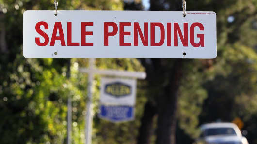 A sale pending sign is posted in front of home for sale in Greenbrae, California.