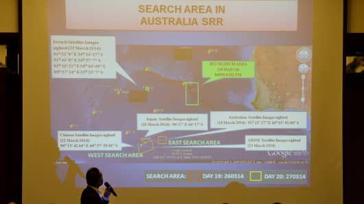 Malaysian officials show Chinese relatives of passengers on the missing Malaysia Airlines flight MH370 the new search area.
