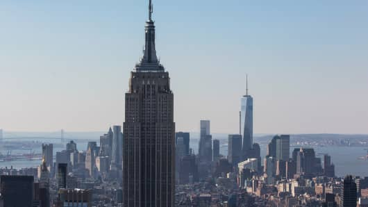 The Empire State Building and One World Trade Center are seen from the top of Rockefeller Center on March 21, 2014.