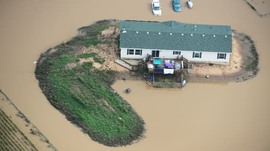 A home surrounded by flood water on a farm in Weld County Colorado, September 14, 2103.