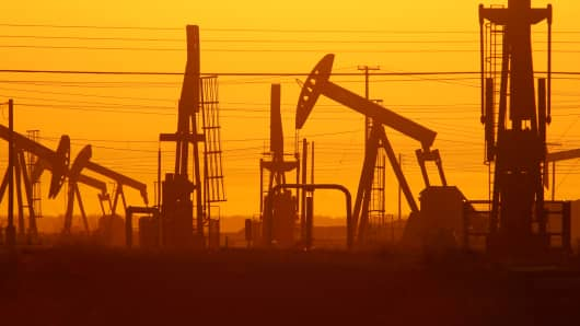 Pump jacks and wells are seen in an oil field on the Monterey Shale formation, March 23, 2014, near McKittrick, Calif.