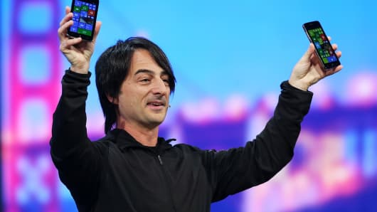 Joe Belfiore, corporate vice president and manager for Windows Phone, holds Windows phones at the 2014 Microsoft Build developer conference on April 2, 2014 in San Francisco.