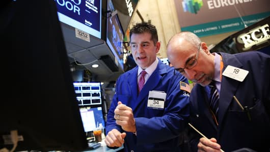 Traders work the floor of the New York Stock Exchange