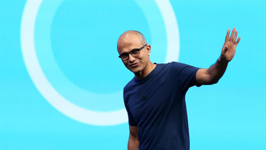Microsoft CEO Satya Nadella in front of the new Cortana logo as he delivers a keynote address during the 2014 Microsoft Build developer conference on April 2, 2014 in San Francisco.