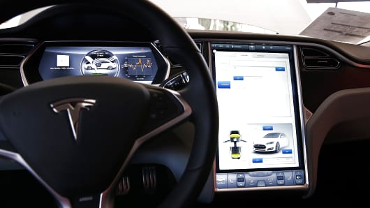 A view of the dashboard in a new Tesla Model S car at a Tesla showroom on November 5, 2013 in Palo Alto, California.