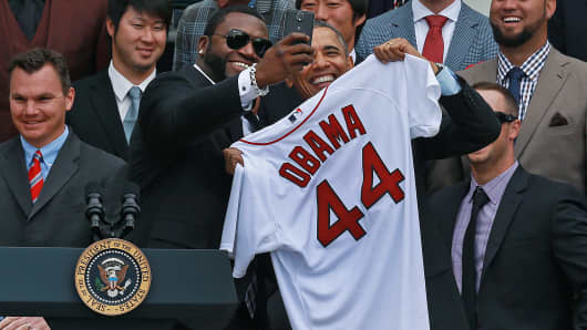 After presenting the president with an 'Obama 44' Red Sox jersey, Boston designated hitter David Ortiz and Obama posed for a 'selfie.'