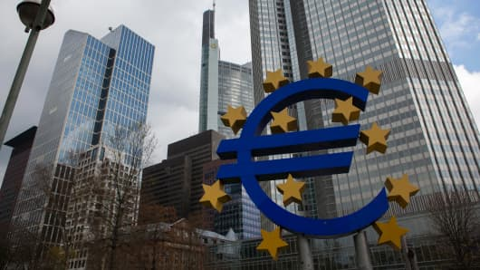 The stars of European Union (EU) membership sit on a euro sign sculpture outside the headquarters of the European Central Bank (ECB) in Frankfurt, Germany.