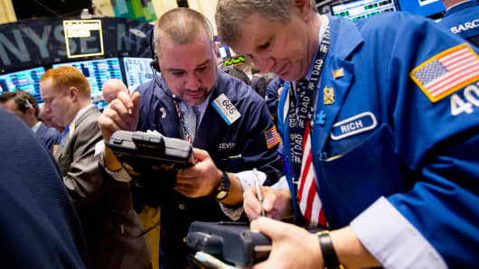 Traders work on the floor of the New York Stock Exchange, Friday, April 4, 2014.