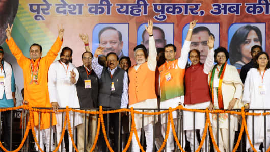 BJP prime ministerial candidate Narendra Modi with all the BJP candidates from Delhi during an election campaign rally at Shashtri Park on March 26, 2014 in New Delhi, India.