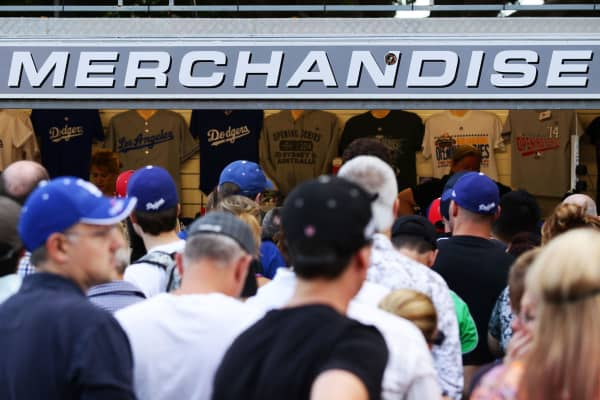 Fans purchase mechandise before the opening match of the MLB season between the Los Angeles Dodgers and the Arizona Diamondbacks at Sydney Cricket Ground on March 22, 2014 in Sydney, Australia.