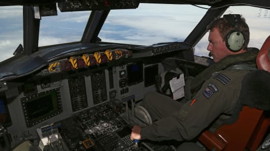 Royal New Zealand Air Force P3 Orion co-pilot Squadron Leader Brett McKenzie flies the plane while searching for missing Malaysia Airlines flight MH370, over the Indian Ocean on March 31, 2014.