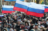 Demonstrators hold Russian flags during a rally in the eastern Ukrainian city of Donetsk on April 5, 2014.