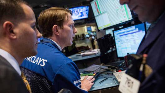 Traders work the floor of the New York Stock Exchange.