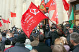Pro-Russian activists hold red flags with the communist hammer and sickle during a rally in the eastern Ukrainian city of Kharkiv on April 7, 2014.