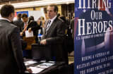A veteran speaks to a job recruiter at a 'Hiring our Heroes' Job Fair on March 27, 2014 in New York City.
