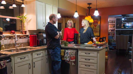 Cathy Tiffany talks with daughter Autumn Selby, 16, and husband Gary Tiffany in their kitchen.