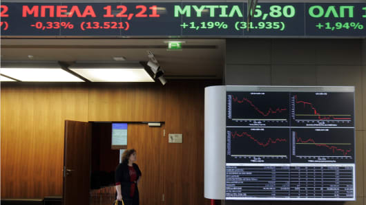 Stock Exchange displays show stock price movements in Athens, Greece