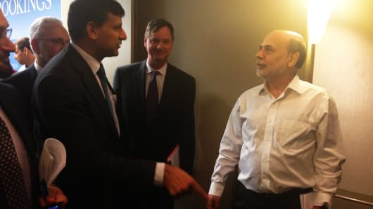 "Despite the earlier exchange, Rajan and Bernanke were cordial afterward. Rajan said ""Ben, I'm going to miss you."" Bernanke's response could not be heard."