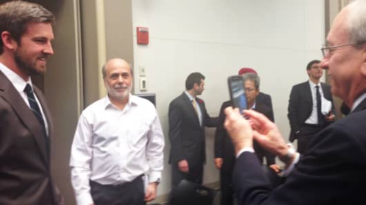 Audience members at the Brookings event on monetary policy take pictures with Bernanke afterward.