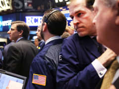 Traders on the floor of the New York Stock Exchange on April 11, 2014