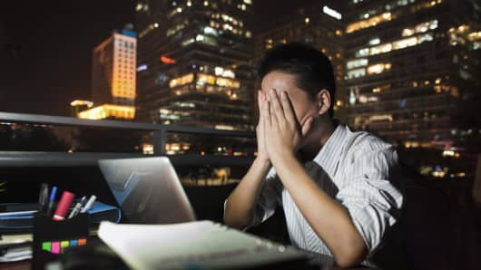 Chinese businessman working at night.
