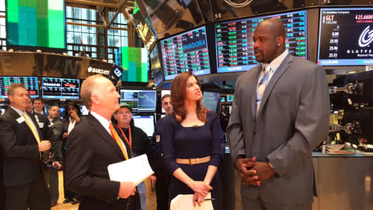 Bill Griffeth, Kelly Evans and Shaquille O'Neal at the New York Stock Exchange, April 14, 2014.