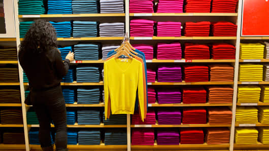 An employee folds clothes at a Uniqlo Co. store on 5th Avenue in New York.