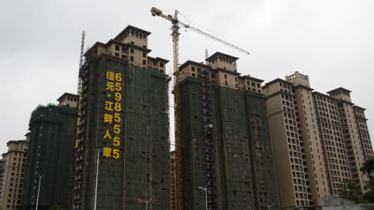Residential buildings stand under construction in Haikou, Hainan Province, China.