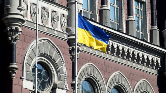 A Ukrainian national flag flies outside the Ukraine central bank in Kiev, Ukraine.