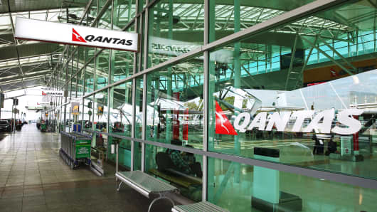 The Qantas Airways logo is displayed at the company's domestic terminal at Sydney Airport in Sydney, Australia.