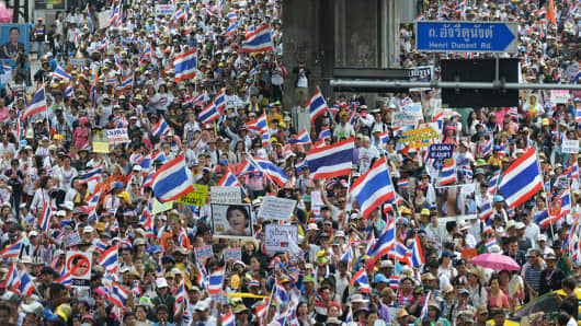 Anti-government protesters march through central Bangkok on March 29.