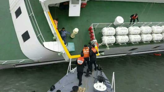 In this handout image provided by the Republic of Korea Coast Guard, passengers are rescued by the Republic of Korea Coast Guard from a ferry sinking off the coast of Jindo Island on April 16, 2014 in Jindo-gun, South Korea.