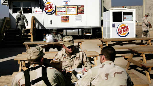 In a file photo dated December 8, 2005, U.S. soldiers have lunch at 'Burger King' at a military base in southern Baghdad.