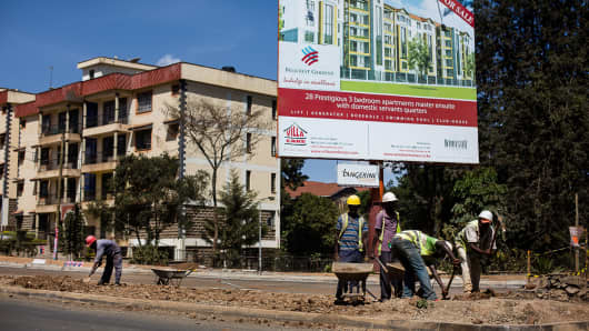 Construction of a new road past an advertisement for a new development of residential apartments in Nairobi, Kenya, March 1, 2013.