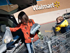Shopper unloads groceries outside a Wal-Mart store in East Peoria, Illinois.