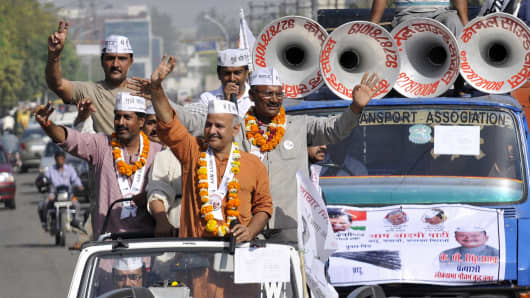 AAP leader Manish Sisodia along with the Lok Sabha candidate for Gautam Budh Nagar seat of Aam Aadmi Party KP Singh during the road show campaign on April 5, 2014 in Noida, India.