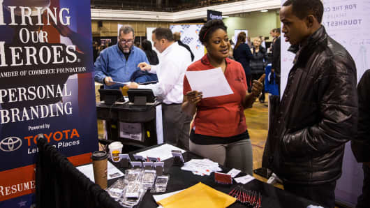 Recruiters speak with applicants at a job fair for veterans in New York City.