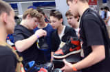 Ryan Horowitz, 14, center, negotiates over a pair of Air Jordan samples that were released only in Shanghai, at the Sole Xchange fair in the Penn Plaza Pavilion in New York, March 22, 2014.