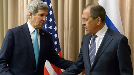U.S. Secretary of State John Kerry, left, shakes hands with Russian Foreign Minister Sergey Lavrov before a bilateral meeting to discuss the ongoing situation in Ukraine, in Geneva Thursday, April 17, 2014.