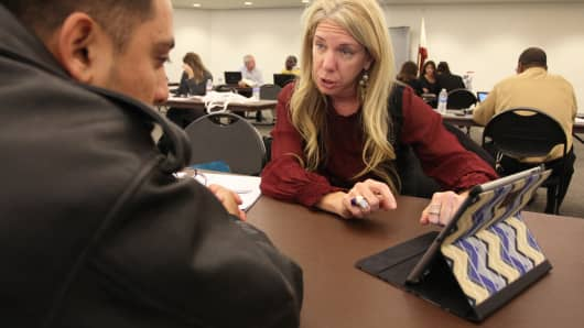 Healthcare specialist Naama Pozniak (R) helps Edgar Loya compare plans at the free Affordable Care Act  Enrollment Fair at Pasadena City College, November 19, 2013 in Pasadena, Calif.