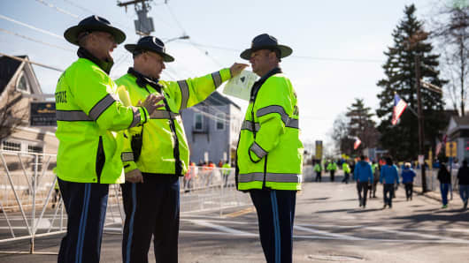 Massachusetts State Police stand guard prior to the start of the Boston Marathon on April 21, 2014 in Hopkington, Massachusetts.