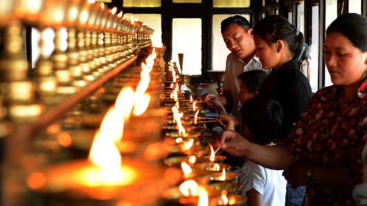 Family members of the Everest avalanche victims light oil lamps at Sherpa Monastery in Kathmandu on April 20, 2014.
