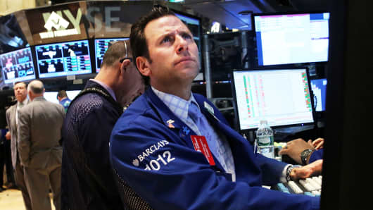 Traders work on the floor of the New York Stock Exchange on April 22, 2014
